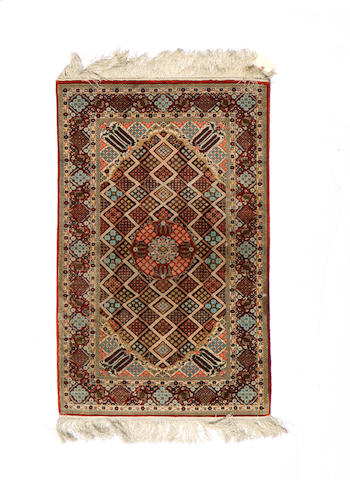 A Chinese rug size approximately 3ft. 1in. x 5ft. 1 1/2in.