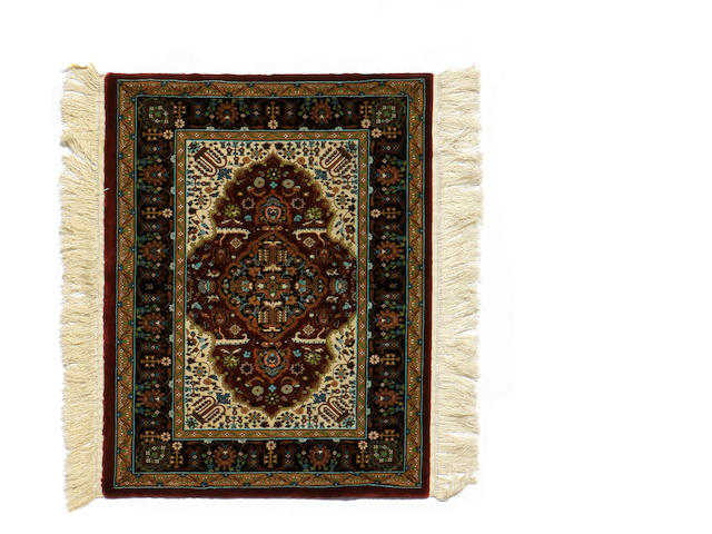A Chinese rug size approximately 2ft. 2in. x 3ft.