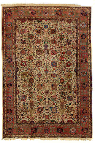 A Tabriz carpet size approximately 10ft. 3in. x 16ft. 3in.