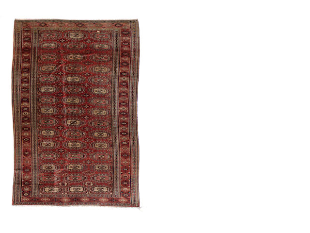 A Turkaman carpet size approximately 8ft. 3in. x 16ft. 1in.