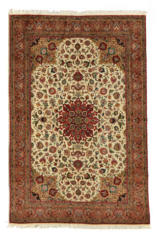 A Tabriz carpet size approximately 6ft. 5in. x 9ft. 9in.
