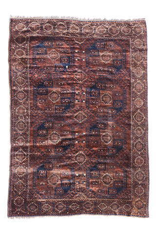 An Afgan carpet size approximately 6ft. 10in. x 9ft. 6in.