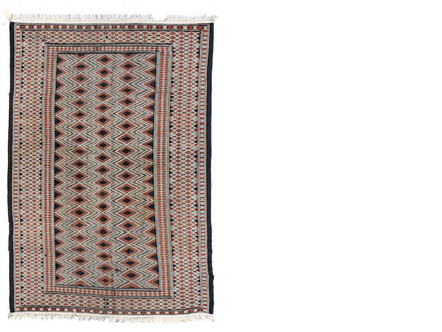 A Moroccan carpet size approximately 7ft. 11in. x 11ft. 7in.
