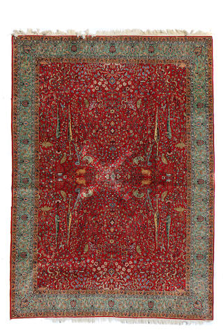 A Tabriz carpet size approximately 8ft. 10in. x 12ft. 4in.