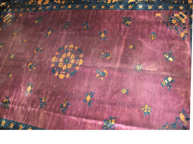 A Chinese carpet  size approximately 12ft. 4in. x 19ft. 3in.