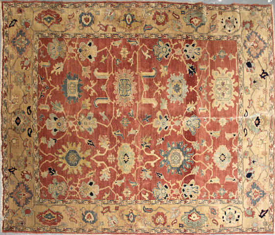 An Egyptain carpet  size approximately 8ft. 1in. x 9ft. 7in.
