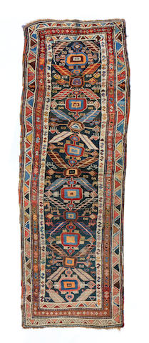 A Northwest Persian runner size approximately 3ft. 8in. x 12ft. 6in.