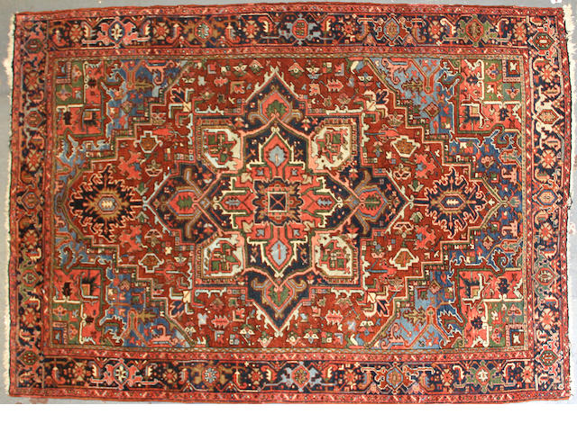 A Heriz carpet size approximately 6ft. 9in. x 9ft. 5in.