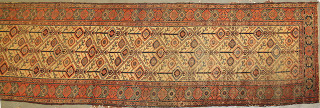 A Hamadan runner size approximately 3ft. 7in. x 19ft. 6in.