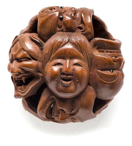 A wood netsuke of a group of masks By Masakazu, Edo period (19th century)