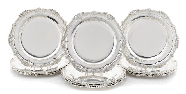A set of twelve Regency  sterling silver  dinner plates by Paul Storr, London,  1812