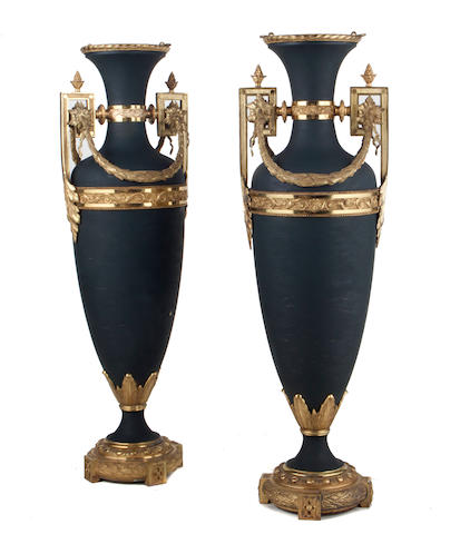A pair of Neoclassical style gilt bronze mounted tôle urns