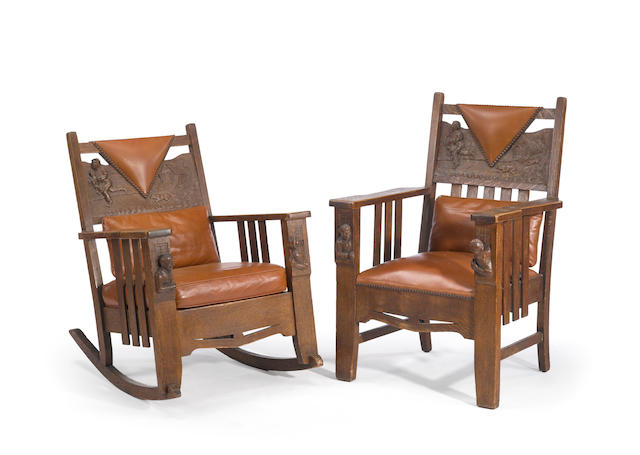 Two American Arts and Crafts carved oak upholstered chairs early 20th century