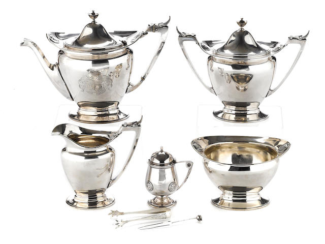 A silver four piece tea set by Gorham Mfg. Co., Providence, RI, circa 1863-1865, retailed by Starr & Marcus <BR />Medallion, # 340  (7)