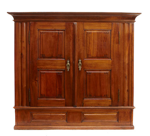 A Continental Baroque carved walnut armoire