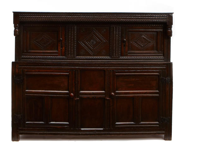 An English carved oak court cupboard