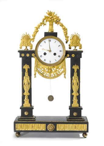 A Directoire gilt-bronze and black marble portico mantel clock<BR />late 18th/early 19th century