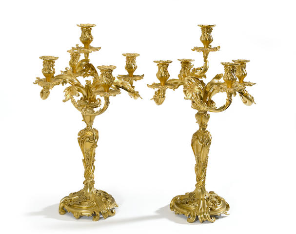 A pair of Louis XV style gilt bronze five light candelabra <BR />second half 19th century