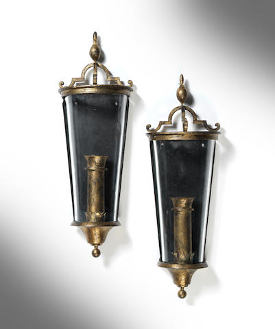 A pair of gilded and glass wall appliques Poillerat, French c 1940