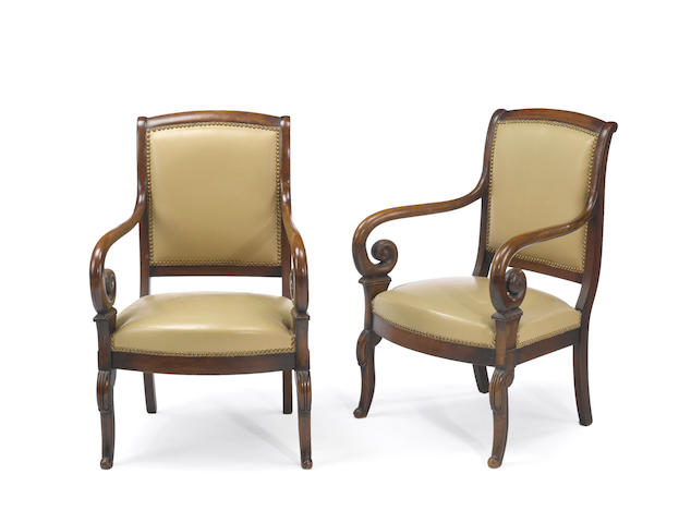 A pair of Charles X mahogany fauteuils with gold leather upholstery<BR /> early 19th century