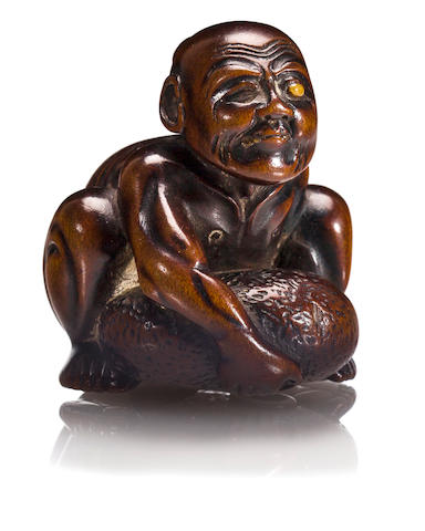 A wood netsuke of stone lifter, by Masanao II, late 19th century