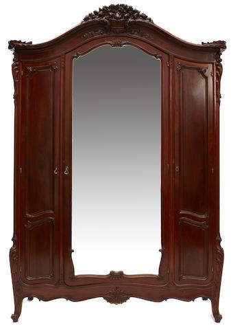 A Louis XV style oak armoire