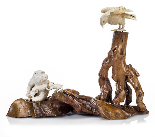 An ivory figural group of monkeys and a hawk Meiji period (late 19th century)