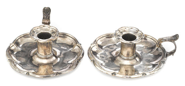 A George IV silver pair of chambersticks William Eaton, London, 1824 With crest engraved on pans and nozzles  (2)