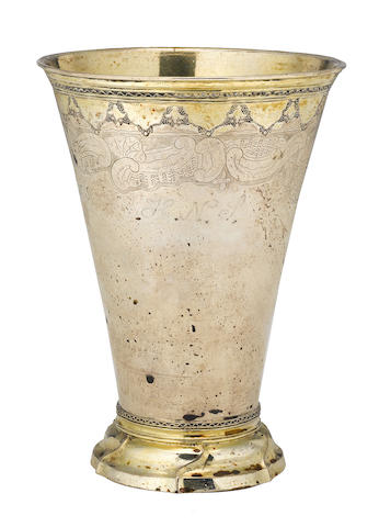 A Swedish parcel-gilt silver beaker with applied, engraved and stamped borders by Lars Eriksson Stabaeus, Stockholm,  1692