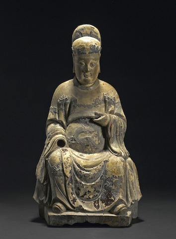 A carved and lacquered wood figure of a seated official Ming dynasty