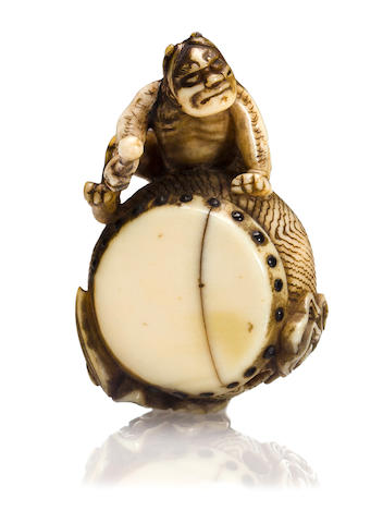 An ivory netsuke of Raiden on a drum By Hidemasa, Edo period (19th century)