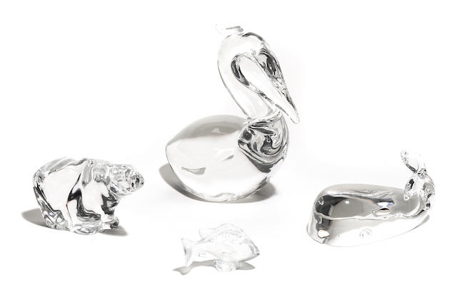 A Steuben glass pelican and whale, A Baccarat glass bear, cat and turtle, a Lalique miniture dragon and fish and a Hadeland glass bear