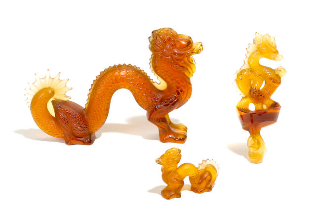 A Lalique large amber glass dragon, a small amber glass dragon and a dragon sculpture