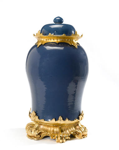 A large Chinese porcelain blue ground baluster covered urn with Louis XV style gilt bronze mounts <BR />late 19th century