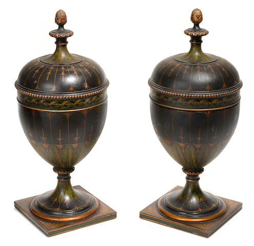 A pair of George III style paint decorated mahogany knife urns