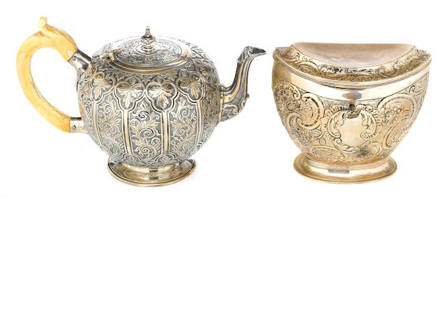 A Victorian silver group of table articles: a teapot with ivory handle with an associated tea caddy by Charles Stuart Harris, London, 1884<BR />and William Comyns, London, 1891  (2)