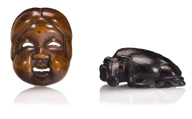 An ebony netsuke and a wood netsuke The first signed XXXX, Edo period (19th century)