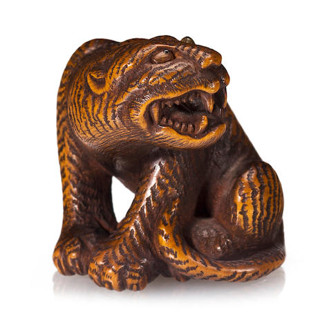 A wood netsuke of a tiger By Harumitsu, Edo period (19th century)