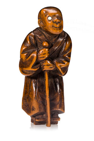 A wood netsuke of a blind masseur Edo period (19th century)