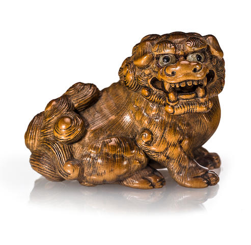 A boxwood netsuke of a shishi Edo period (19th century)