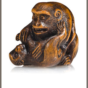 A wood netsuke of monkeys. By Ran'ichi, 19th century