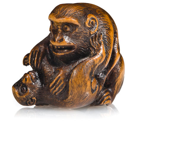 A wood netsuke of monkeys<BR />By Ran'ichi, 19th century