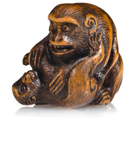 A wood netsuke of monkeys<BR />By Ran'ichi, 19th century