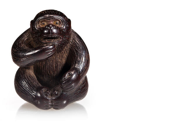 An ebony wood netsuke of a monkey<BR />By Minko, 18th/19th century