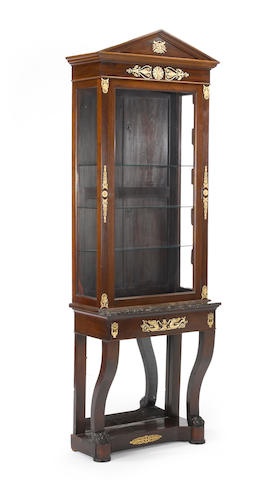 An Empire gilt bronze and brass mounted mahogany vitrine cabinet and console table <BR />console first quarter of 19th century<BR /> cabinet 20th century