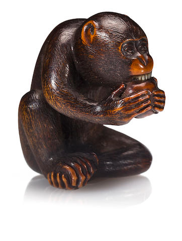 A large wood netsuke of a monkey By Masanao, Edo period (19th century)