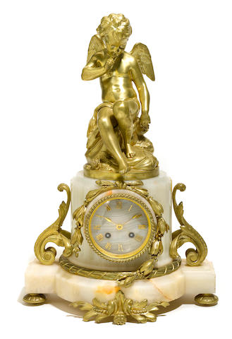 A Louis XVI style gilt bronze mounted onyx clock
