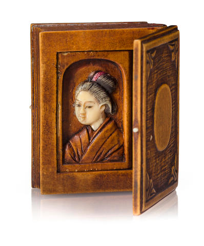A wood and ivory erotic netsuke Meiji period (late 19th century)