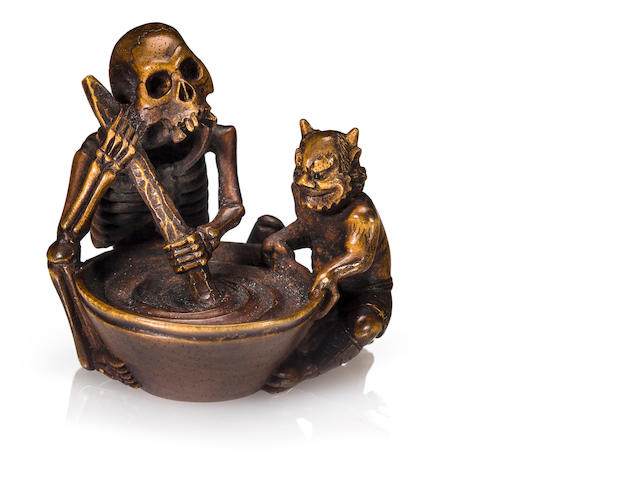 A wood netsuke of a skeleton and an oni By Shoko Sugunoya, Takayama, Edo period (19th century)