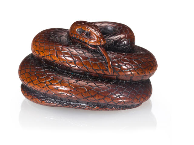 A wood netsuke of a coiled snake By Kokei, early 19th century